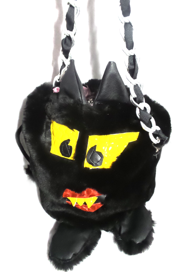 Upcycled fur monster theme handbag with Fendi elements