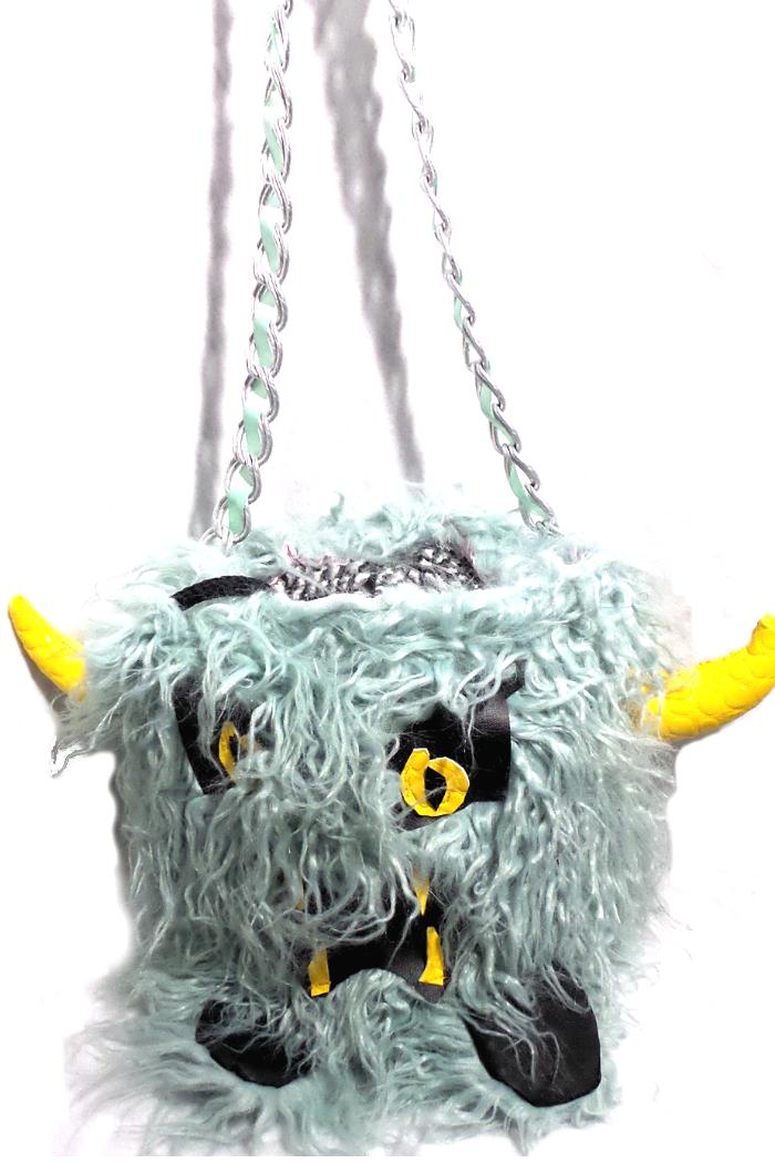 Drawstring bucket horned monster handbag