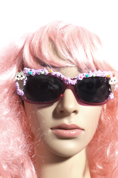 View of how ice cream cone decora sunglasses fit on face