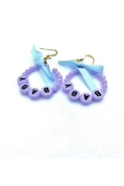 Purple earrings with a word 'baby' on them