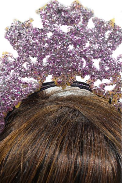 Closeup of pink crown headband