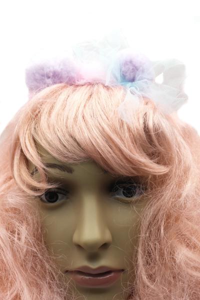 Front view of mini pom pom headband