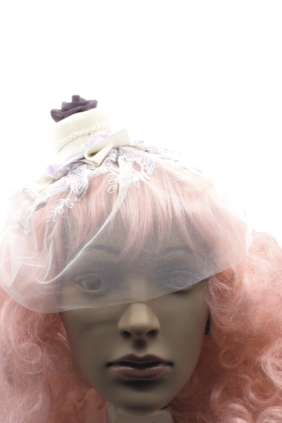 purple cake with wedding veil front view