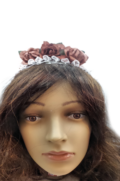 Roses and lace sit on top of a headband