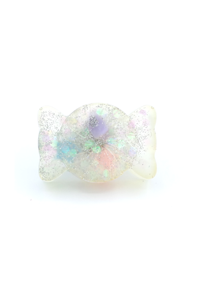Acrylic ring shaped like wrapped candy with plastic stars inside