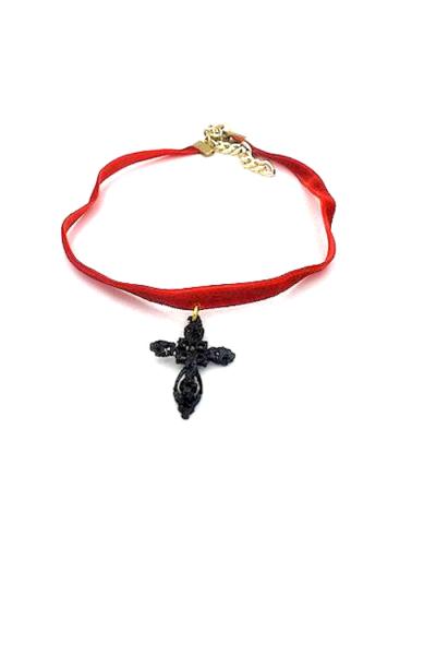Ornate cross charm on velvet corsd and gold chain
