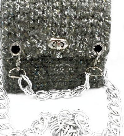 Hang charms from this crocheted bag with chain detail.