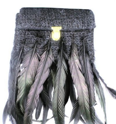 feather and worn handbag with long feathers and hand crocheted.