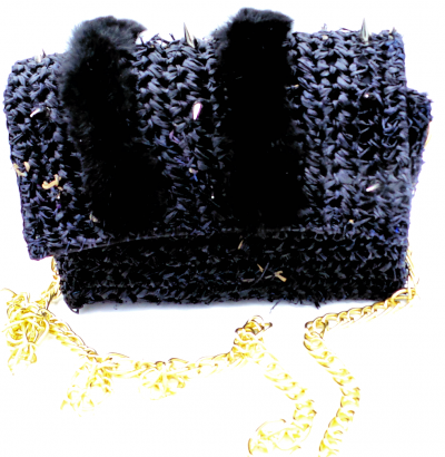 Black straw bag with faux fur and spikes on flap. Snap closure and gold chain strap.