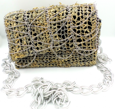 Gray straw bag with lattice chain detail and chain straps.