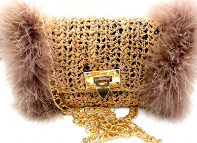 Natural color straw crossbody bag with feather boa on sides and gold flip lock.